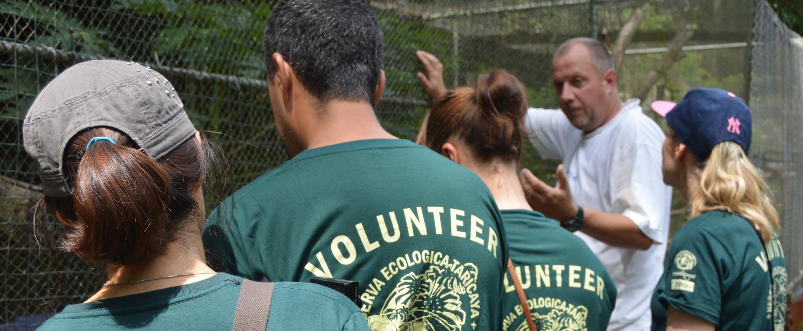 Stuart Timson take the Conservation volunteers on a tour of the animal rescue centre in Peru